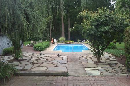 Expanding the pool area with an irregular flagstone patio made a wonderful addition to this Boyertown, Pa backyard.
