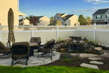 Gilbertsville PA patio with water feature and privacy fence