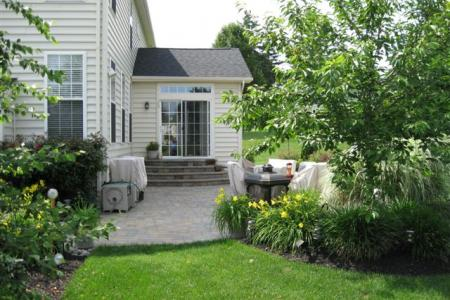 Half moon steps and a paver patio in Pottstown, Pa create a welcoming area to relax and entertain.