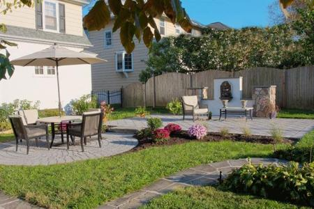 Paver patio with dining area creates a functional outdoor living area in Phoenixville, PA