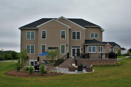 Patio in Phoenixville, PA with deck, grill and umbrella