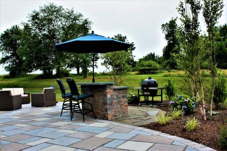 Phoenixville patio with umbrella, stone bar and grill