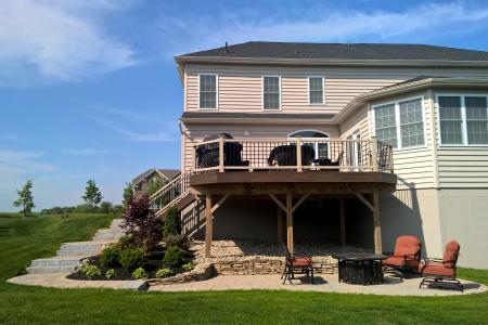Patio in Phoenixville, PA with deck and chairs