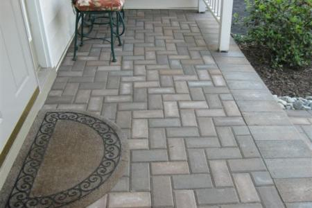 A concrete porch in Spring City, Pa. is greatly enhanced with this paver overlay installation.