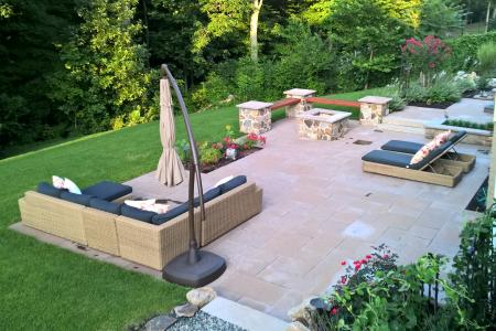 Patio in Pottstown PA with umbrella, chairs and shrubbery