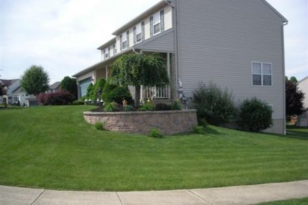 This Techo-Bloc retaining wall allows this Shillington, Pa homeowner to elevate a sloping foundation for plantings.