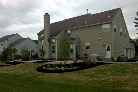 Schwenksville, PA patio with boulders, landscaping and trees