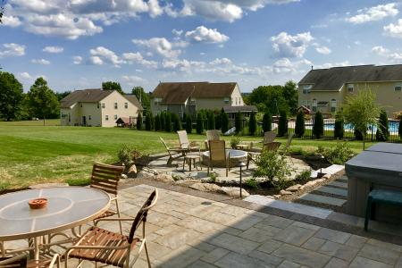Patio in Schwenksville, PA with stamped pavers, flagstone and firepit
