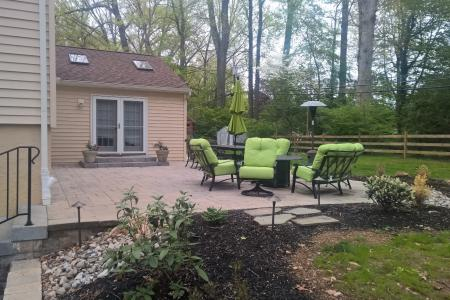 Patio in Wayne, PA with green outdoor chairs