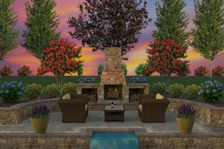 Outdoor fireplace and landscaping providing intimate seating area.