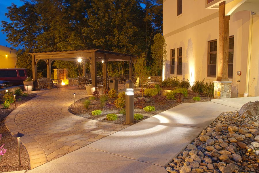 Outdoor lighting at night with patios and walkways
