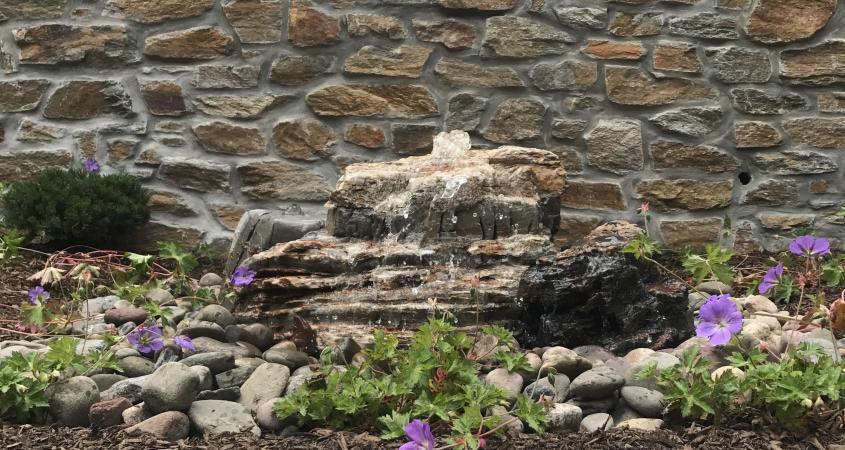 Boulder water fountain installed in a Schwenksville backyard