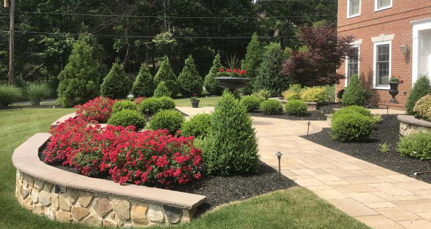 Landscaping, retaining wall, paver walkway and circular inlet in Malvern, PA