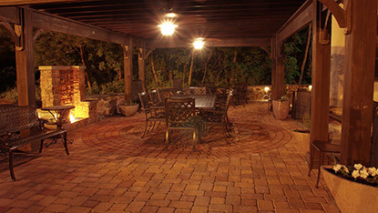back yard landscaping with lights pergola and patio pavers